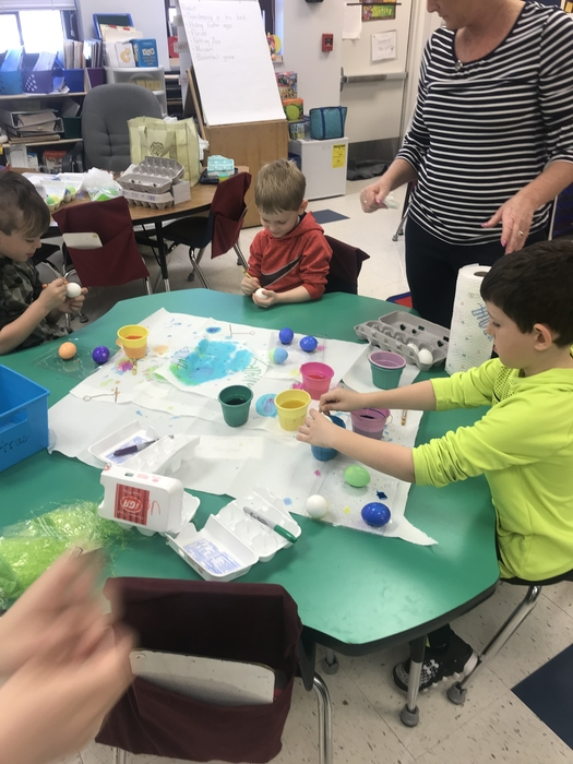 Kindergarteners decorating eggs